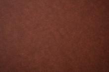 茶色い革調の紙のテク...
