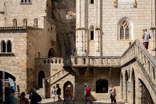 Fotografia, Obraz Stone walls of historic Basilica of St-Sauveur blend into the cliff in Rocamadou