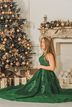 Christmas Or New Year Holidays Magical Atmosphere And Pretty Woman In Luxury Dress. Concept Of Celebrate