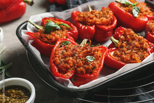 Obraz Baking dish with tasty stuffed pepper and sauce on table - fototapety do salonu