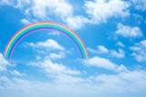Fototapeta Rainbow - rainbow in cloudy sky