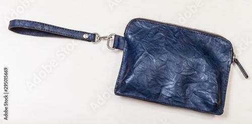 closed small wristlet purse bag on pale table Fototapeta