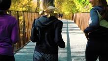 Positive Friends Jogging On Br...
