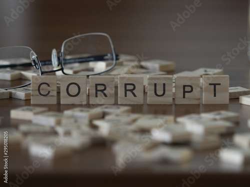 Valokuvatapetti The concept of Corrupt represented by wooden letter tiles