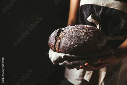 Fotografia, Obraz rustic bread in baker hand, healthy food