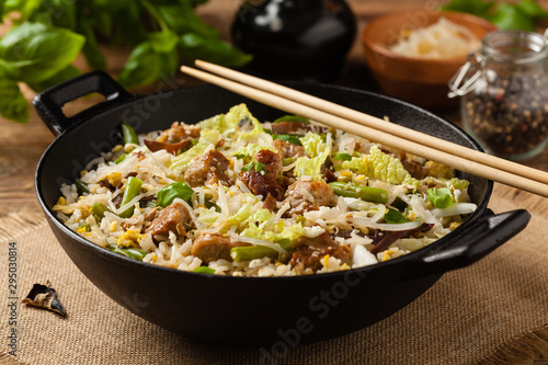 Valokuvatapetti Fried veal, with rice, Chinese cabbage and mushrooms