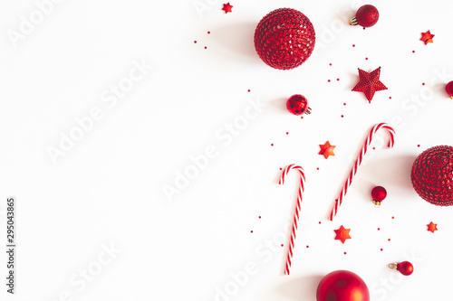 Fototapeta Christmas composition. Red decorations on white background. Christmas, winter, new year concept. Flat lay, top view, copy space obraz na płótnie
