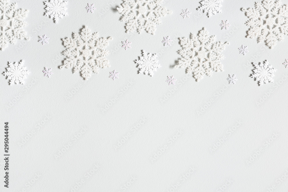 Fototapeta Christmas composition. Border made of snowflakes on pastel gray background. Christmas, winter, new year concept. Flat lay, top view, copy space
