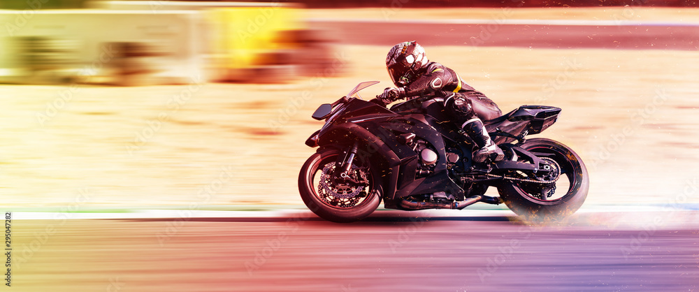 Fototapeta motorcycle racer rides on a sports track