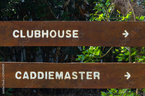 Fotografie, Obraz Golf Course Signs Clubhouse Caddie Master Wood Engraving Closeup