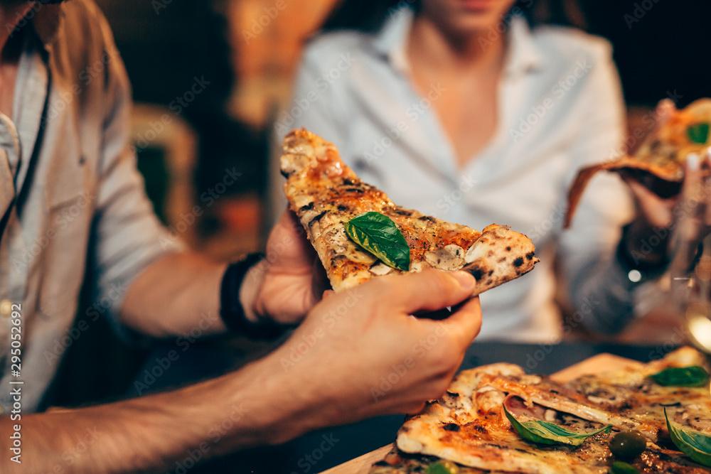 Fototapety, obrazy: closeup friends eating pizza. night scene