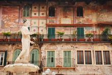 The Roman Statue, The Madonna Verona, Atop The Fountain In Piazza Delle Erbe In Verona, Veneto. The City Has Been Awarded UNESCO World Heritage Site Status