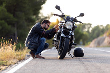 Young Man Biker Checking His M...