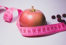 A Red Apple With A Tape Measur...