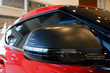 red sports car mirror