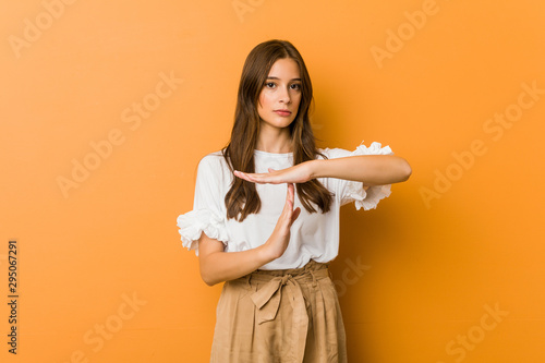 Young caucasian woman showing a timeout gesture. Fototapeta