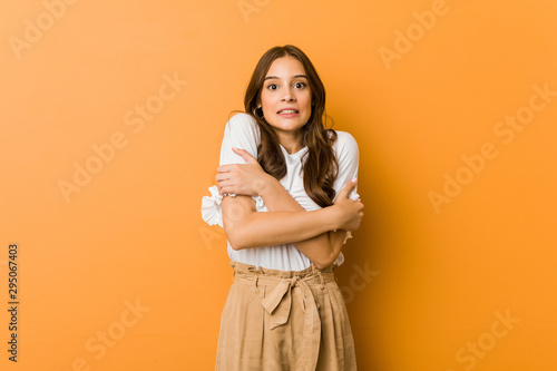 Fototapeta  Young caucasian woman going cold due to low temperature or a sickness