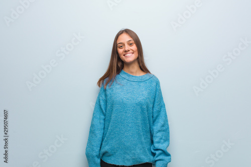 Valokuva Young pretty woman wearing a blue sweater cheerful with a big smile