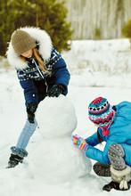 Friends Building A Snowman. Fu...