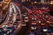 Leinwanddruck Bild - Car traffic jams due to snowfall in the evening.