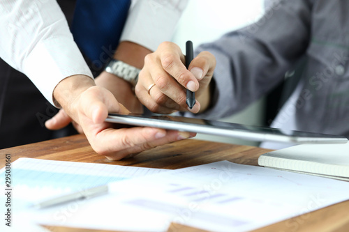 Focus on workers hands holding tablet Canvas
