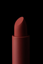 Red Matte Lipstick Macro Close-up Isolated On Black Background..