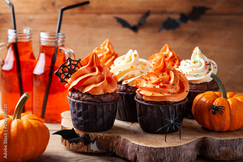 Fototapety, obrazy: Halloween cupcakes and pumpkins on wooden background. Sweets for holiday party.