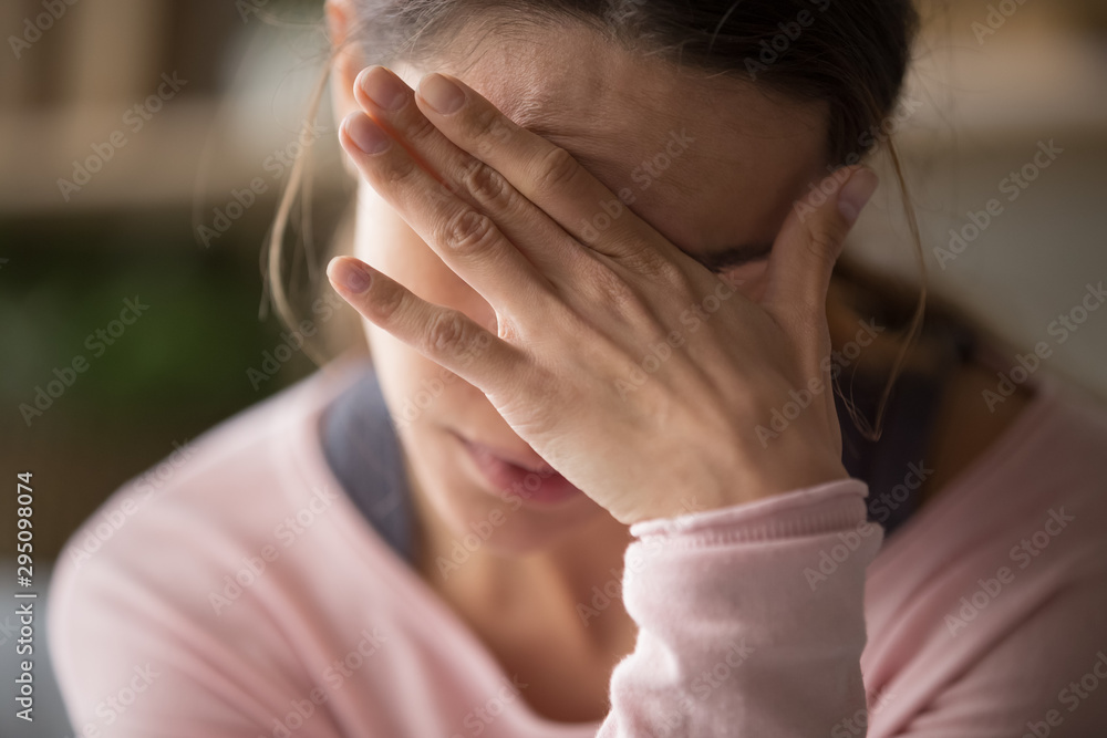 Fototapety, obrazy: Sad tired woman touching face having headache or depression