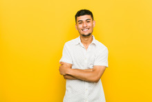 Young Hispanic Man Laughing And Having Fun.