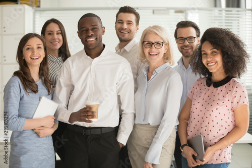 Positive multi racial corporate team posing looking at camera Tableau sur Toile
