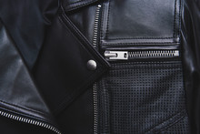 Black Leather Jacket With Perforated Elements. Metal Zipper, Clasp And Button. Classic Clothes For Biker. Detailed Closeup View. Beautiful Background.