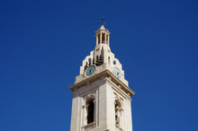 White High Clock Tower Blue Sky Background