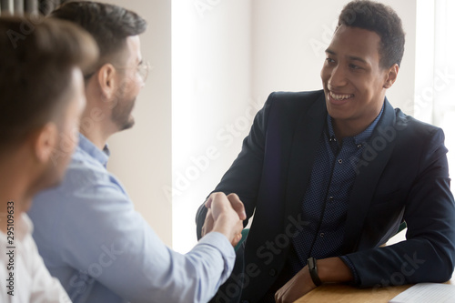 Diverse business partners colleagues shake hands at group meeting Canvas Print