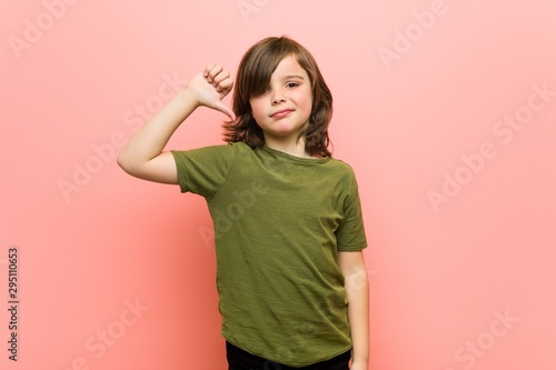 Little boy showing a dislike gesture, thumbs down Canvas Print