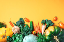 Autumn Vegetables On Trendy Yellow Background. Top View. Vegan And Vegetarian Diet, Harvest Concept. Ingredients For Cooking - Pumpkin, Tomatoes, Cucumber, Pepper, Kale, Broccoli, Celery