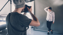 Fashion Photo Shoot. Professional Occupation Hobby. Male Model Posing In Studio. Session Backstage.