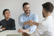 Leinwandbild Motiv Smiling male hr manager handshake applicant at job interview