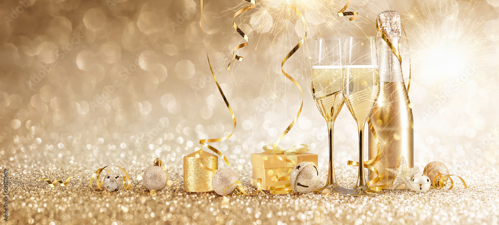 Fototapeta New Years Eve Celebration with Champagne and Confetti