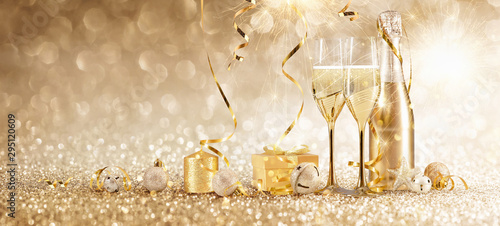 Fototapeta New Years Eve Celebration with Champagne and Confetti obraz