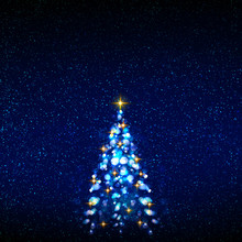 Colorful Christmas Tree Isolated On Blue Sky Background.