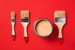 Leinwanddruck Bild - Brush and open paint can on trendy red background. Top view, copy space. Appartment renovation, repair, building and home design concept.