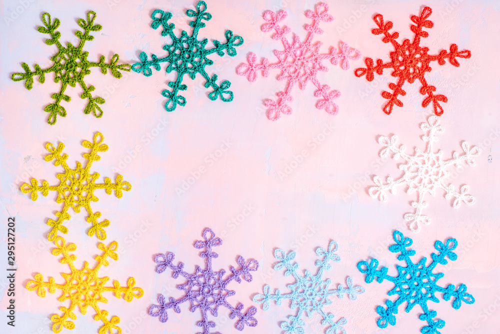 Fototapety, obrazy: Crocheted multi-colored snowflakes. Crocheted doily. Handmade creativity. Bright christmas card on pink and purple background. Flat lay,top view, copy space.