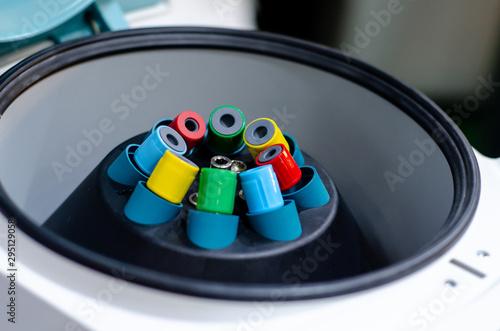 Photo Close-up of centrifuge test tube mixer.