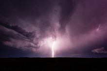 Powerful Bolt Of Lightning Striking The Ground During Thunderstorm.