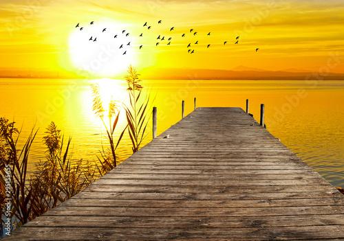 obraz lub plakat atardecer en el mar desde el embarcadero