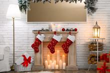 Decorative Fireplace In Stylish Room Interior. Christmas Celebration
