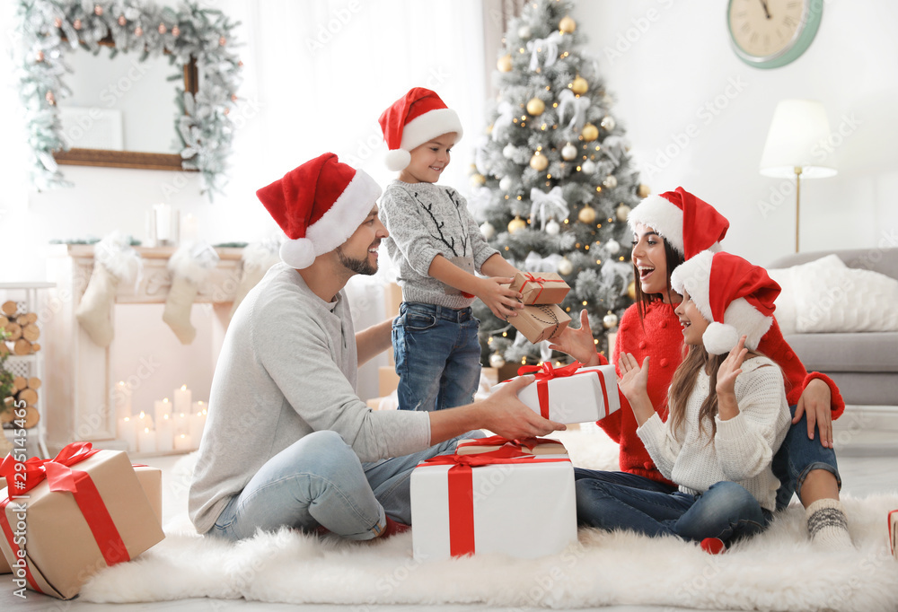 Fototapety, obrazy: Happy family with children and Christmas gifts on floor at home