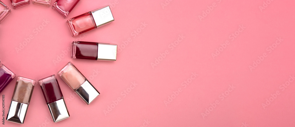 Fototapety, obrazy: nail polishes of different colors are built on a pink background concept flat lay