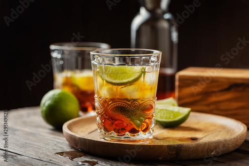 Strong golden rum with lime and ice