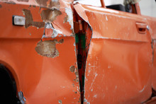 Old Rusty Red Car With Dented Wing
